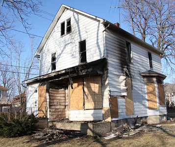 24FEB13__ This house at 251 Connecticut Ave. in Lorain, which is scheduled for demolition, was one of the fires the Lorain Central Fire station responded to at 4:40 AM on Sunday morning. photo by Ray Riedel