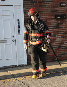 24FEB13__ Fireman John Crum exits the fire investigation on G Street after a call regarding a possible electrical fire.photo by Ray Riedel