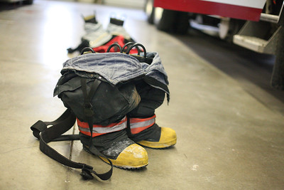 24FEB13__ Firemen leave their boots near the truck, ready to step into. photo by Ray Riedel