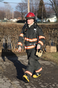 24FEB13__ Fireman John Crum on the scene of a potential fire on G street in Lorain. photo by Ray Riedel