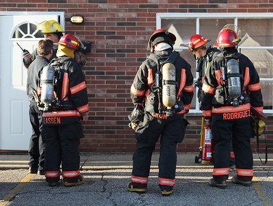 24FEB13__ Firemen Crum and Rodriguez from Central Fire Station in Lorain await further instructions from the incident commander where a potential electrical fire had been reported, but find the burning smell was likely due to a neighbor's self-cleaning oven. photo by Ray Riedel