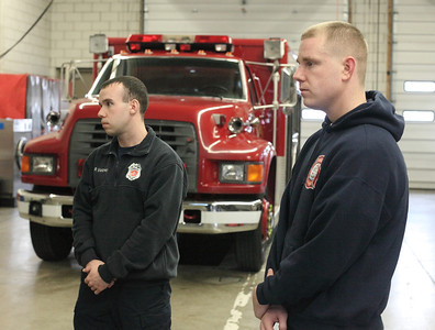 24FEB13__ Lorain Firemen Patrick Mackey (left) and John Crum (right) answer questions about the coming layoff at the Central Fire Headquarters on Broadway in Lorain. photo by Ray Riedel