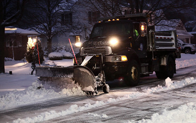 Ben Sanborn plows a small side street south of West Erie Avenue in Lorain.  photo by Ray Riedel