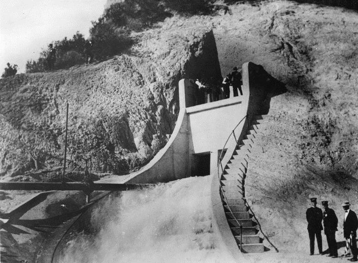 . (November 5, 1913) - Official Opening of the water gates of the Los Angeles Aqueduct. To the lower right can be seen two policeman who stand watch as the water gates are opened.   (DWP)