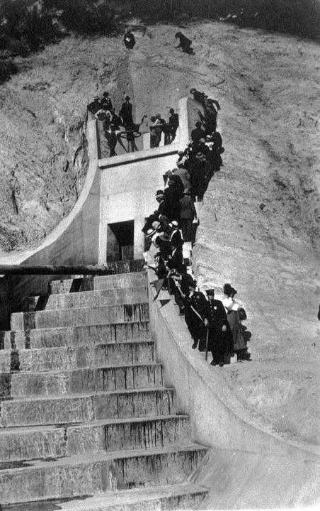 . (November 5, 1913) People climb up the hill to where the water gate valves are located in anticipation of getting the best view when the LA Aqueduct water is released.   (DWP)
