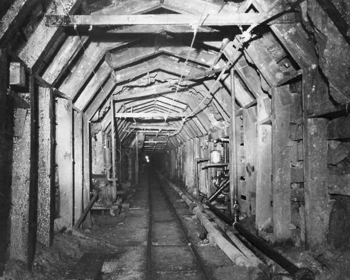 . Tunneling was the most difficult phrase of the construction of the Los Angeles Aqueduct. Photo shows interior of a tunnel. (1910)  (Los Angeles Public Library)
