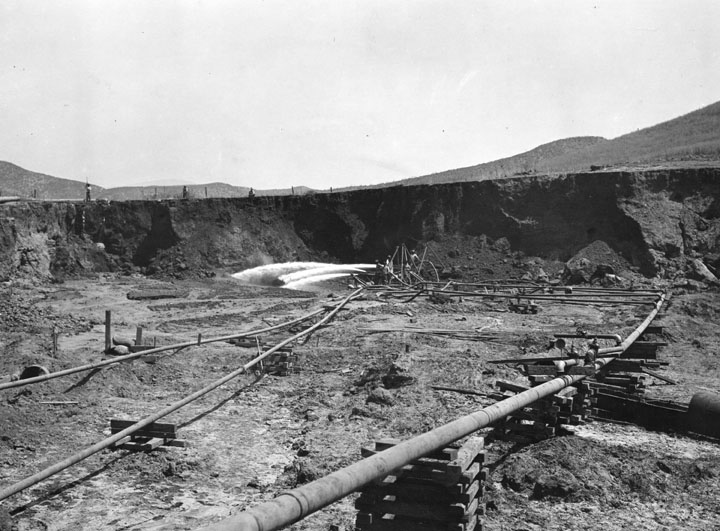 . A view of early excavation for building the L.A. Aqueduct to Owens Valley, done between 1907 and 1913. The aqueduct was considered the 2nd greatest engineering accomplishment of its age, after the Panama Canal. Water was piped in and used under pressure for excavation. (1910)   (Los Angeles Public Library)