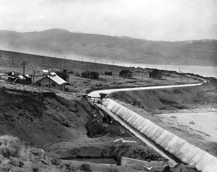 ". Owens Valley during the planning and construction period of the Los Angeles Aqueduct. In this view, the aqueduct skirts around Owens Lake, a ""dead sea,\"" with no outlet to the ocean. (Los Angeles Public Library)"