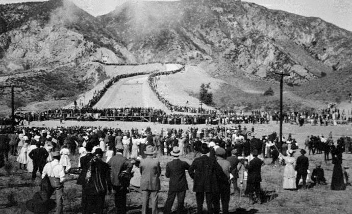 . (November 5, 1913) - The water gates are finally opened and people watch in amazement as the Los Angeles Aqueduct water starts to flow down the cascades into the San Fernando Valley.  (DWP)