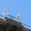 A close up of the lights on the original bridge opened in 1913.  It was the bridge over the arroyo of Route 66.  Now it's Colorado Boulevard.  It's also known as suicide bridge.  The first suicide was 6 years after it opened and to this point there are 100 known suicides jumping from the bridge.