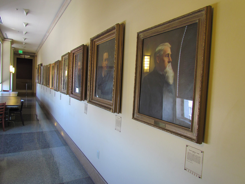 One of the hallways on the 26th floor.  There are portraits of all of the previous mayors of the city.