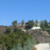 A closeup of the house with its campanile.  It was owned by Madonna but she sold it. The antenna is by the Hollywood sign.