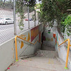 The stairs going to the subway.  This is near the community garden wall.  The subway was built to help kids get from one side of the freeway to the other safely.  The Solano Avenue Elementary School is on the other side of the freeway.