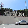 A sculpture at the back of a parking lot between the Italian American Center and St. Peter's Italian Catholic Church.