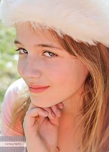 Laura Harris white hat hand under chin-