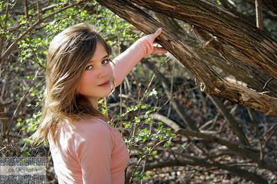 Laura Harris hand on tree-