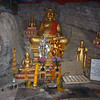 Buddhas in cave on Mt Phousi