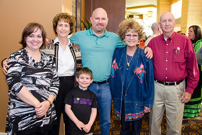 Roger and Carolyn Guthrie and son Andrew, 6, and Bill and Melanie Guthrie and Charlotte Young gather at the Lubbock meeting.