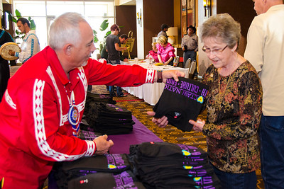 Larry Wade helps pass out t-shirts at the Lubbock meeting.