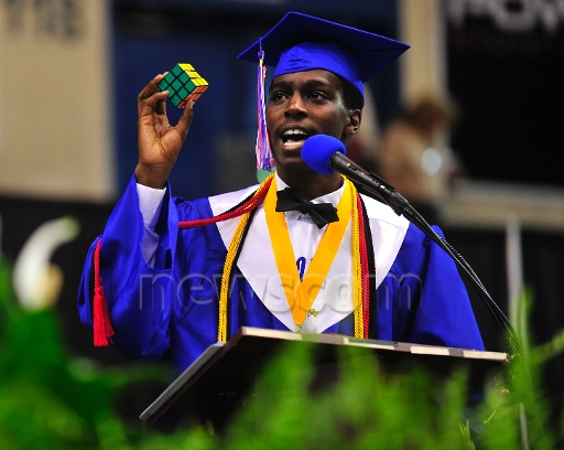CO18.1 / Speaking on special occasions.<br /> <br /> Choice 12 of 13<br /> <br /> May 28, 2014 - Augusta, Georgia, U.S. - Valedictorian Eniolufe Asebiomo gives his address, telling his classmates to solve that Rubiks Cube of life and dare to do the impossible,'' during Westside High School's commencement at James Brown Arena on Wednesday, May 28, 2014