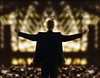 P10.1 /CO10: Beginning and ending: Speaker greeting an audience from podium or waving to a crowd.  <br /> Choice 1 of 9<br /> <br /> Speaker addressing an audience/ Image by © Ocean/Corbis