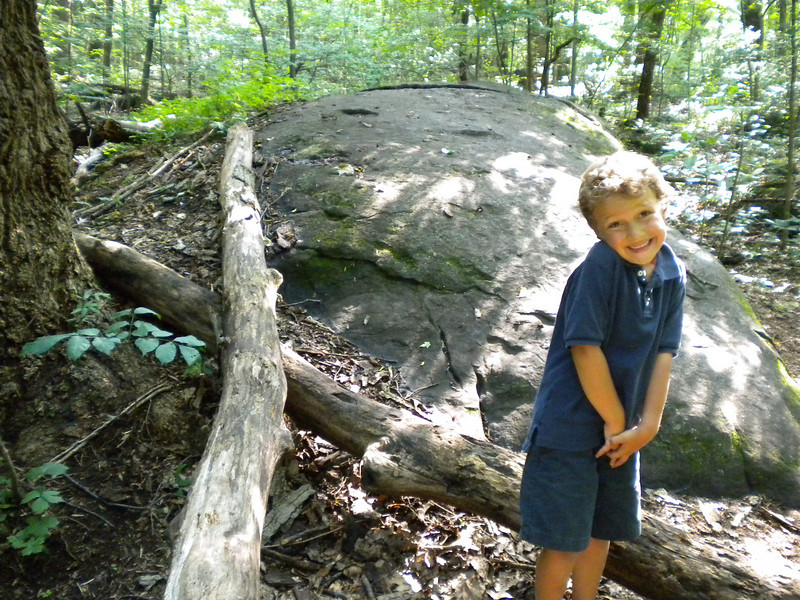 """[Photo by Lydia Yoder]  Xavier with a wooden """"X"""" we found on our walk near Ringing Rocks"""