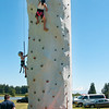 Two unidentified young ladies making their ascent of the climbing tower with Mt Baker on the background