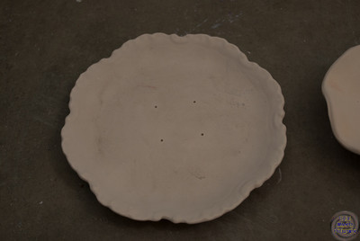 7 Inch diameter with scalloped edges.