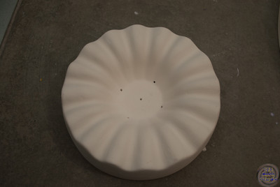 6.5 inch diameter, fluted edges