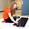 J.S.CARRAS - JCARRAS@DIGITALFIRSTMEDIA.COM      Saratoga High School student Abby DelBridge paints scenes for upcoming production of Cinderella Wednesday, March 4, 2015 at Saratoga High School in Saratoga Springs, N.Y..