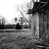 Derelict well house (right) and filled-in swimming pond (left). The next photo from around 1974 was taken at this exact same location.<br /> Bill D Quarter Ranch<br /> Autauga County, Alabama