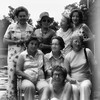"My mother (front center) and her seven sisters at the same spot in the previous photo. Hallie Walls, middle row left, then owned the Bill D Quarter. The only one left is my Aunt Willa ""Scooter"" Scott, top right. I don't know who took this photo, but I think it was at a family reunion in about 1974. Notice the water in the swimming pond (left)."