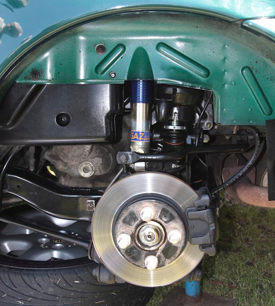 Rear suspension sytem with coil spring and gas shock absorber conversion installed.