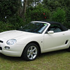 """Eric and Dawn Hayes' MGF 120 ZF CVT, MY 2000. Built August 2000, bought new from Trivet Classic Cars Parramatta. First registered November 2001, NSW plate: ALD 68X. VIN: SARRDWBGJ1D524438, Engine No: 18K4FM13382648, Old English White (same as Jaguar MK 2), interior: Charcoal leather. The automatic transmission cars were fitted with """"top of the range"""" upholstery.  Odometer: 42,300 km (8/2011). Eric and Dawn have driven the MGF to nine National meetings including Adelaide and Tasmania. It has built up an impressive Concours history over the years."""