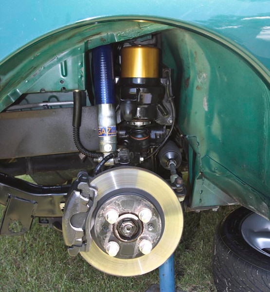 Front suspension sytem with coil spring and gas shock absorber conversion installed.