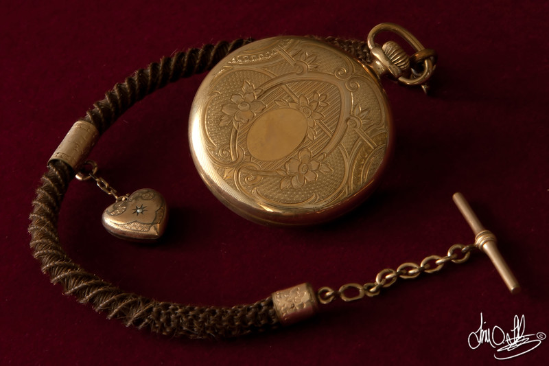 Old pocket watch with a Victorian human hair watch chain