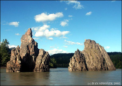 """THREE SISTERS ROCKS"",(only two showing),Stikine river,B.C.,Canada-----""SKALY TRI SESTRY"",(jedna je mimo),reka Stikine,B.K.,Kanada."