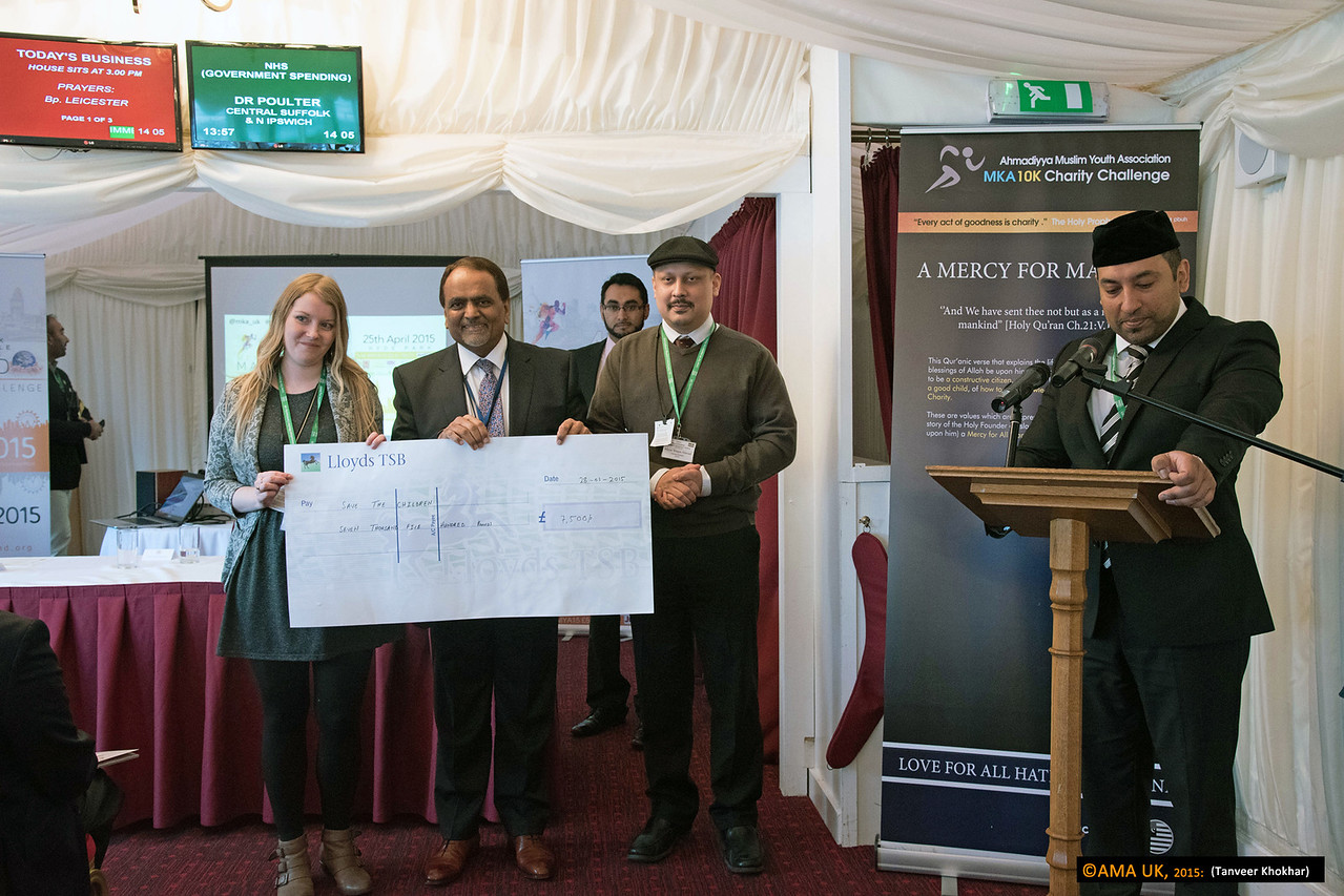 Cheque for Save the Children for £7,500<br /> <br /> MKA House of Lords-2355