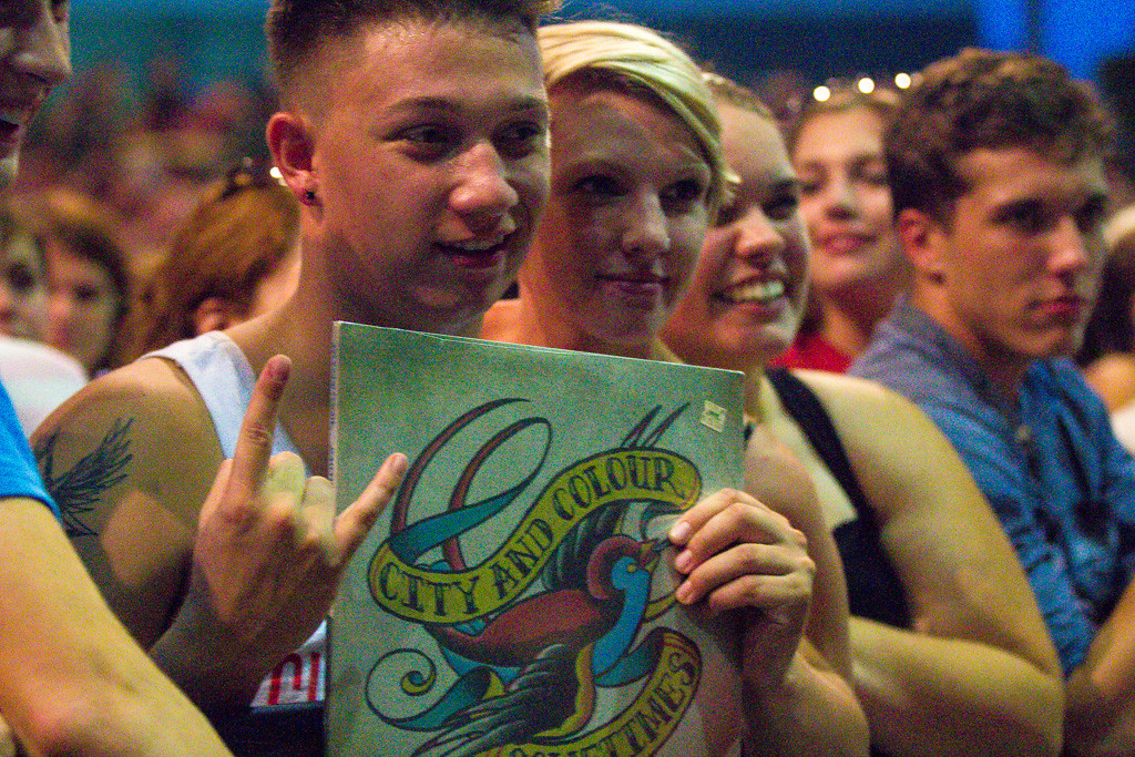 . A fan holds up his City & Colour record during the group\'s set. - 6/12/2014. Photos by Dylan Dulberg/Special to The Oakland Press