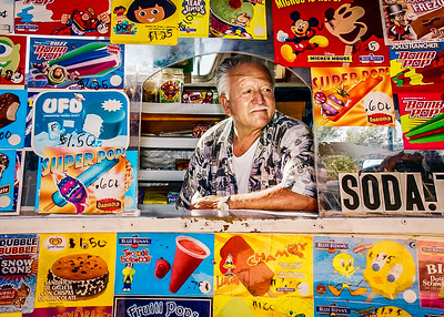 John Galayda / Staff Photographer Ice cream vendor Emmanuel Curiel waits for customers in his truck Friday on Fourth Street in Victorville.