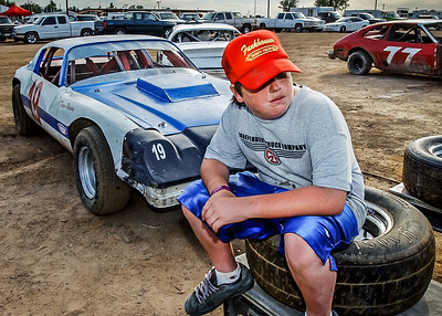 John Galayda / Staff Photographer Andrew Funkhouser, 14, hangs out in the racing pits Saturday before his father's race at the Route 66 Raceway in Victorville.