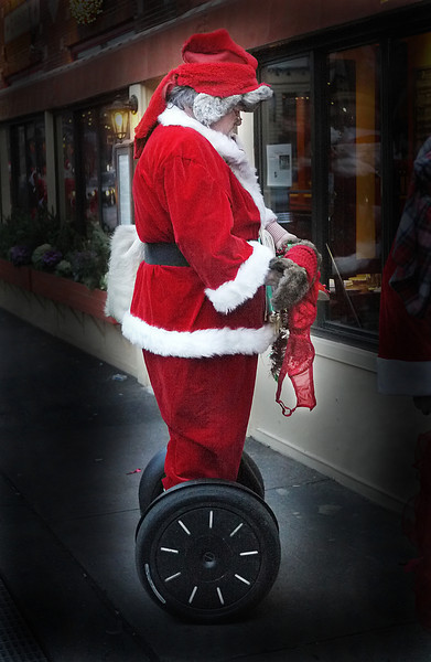 SANTA AFTER A NIGHT OUT ON HIS SEGWAY, DECIDING WHAT HE'S GOING TO TELL MRS. CLAUS.