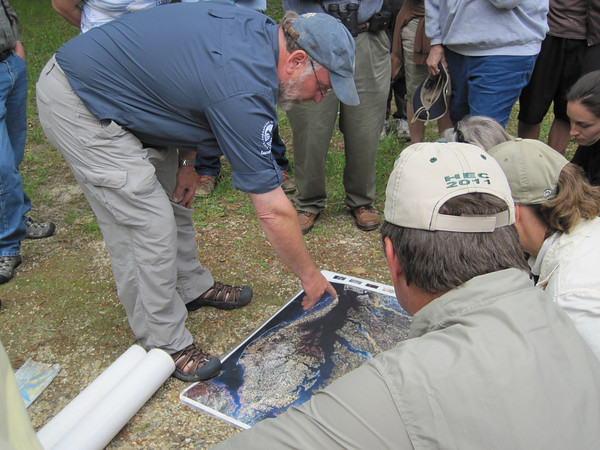 Bill Portlock showing a map of the area.