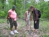 Participants dig up a soil sample.