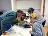 MWEE Leadership Institute participants search through leaf packs to find macroinvertebrates.