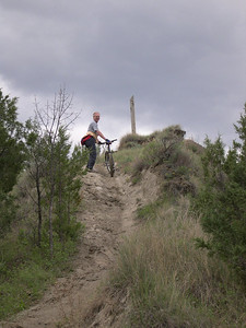 dad, muddy trail, and darkening skies