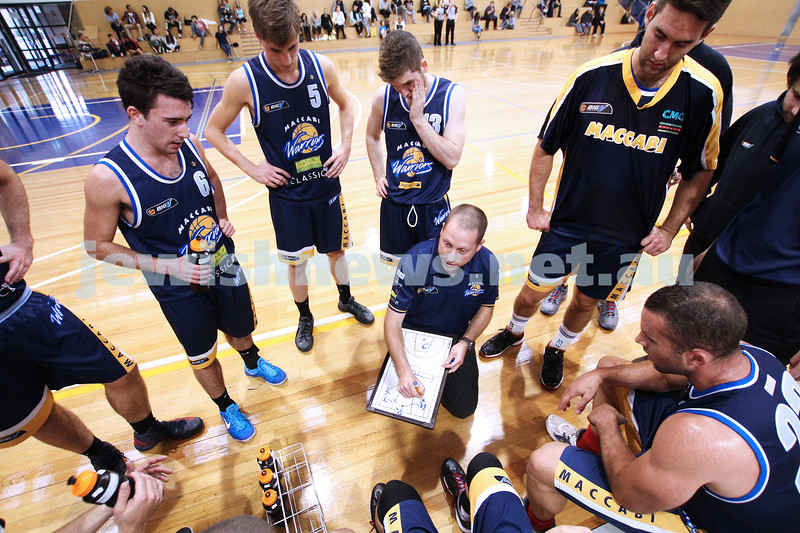 28-4-13. Basketball. Maccabi Warriors v Coburg at Bialik College.  Coach Drew Solewicz adresses the team at a time out. . Photo: Peter Haskin