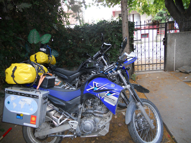 James has just managed to get the bikes in through the narrow gate of the hostel!