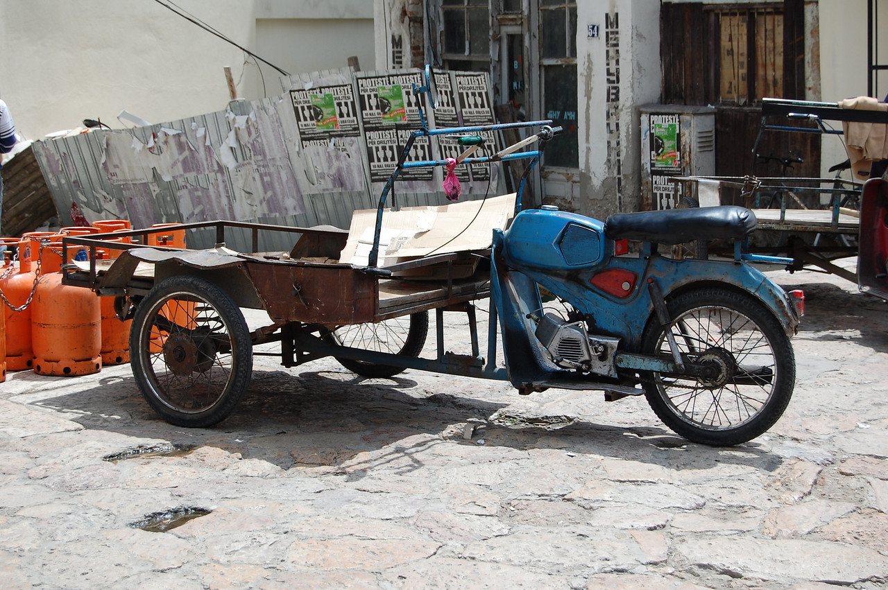 Saw a motorbike in half, attach the front to a cart and steer by turning the cart. Genius! These are everywhere in the Balkans.
