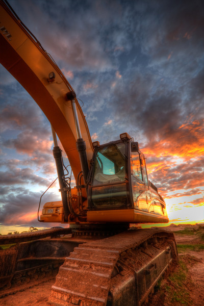 On Fire................. A Excavator on the sunrise of it's first day of work.